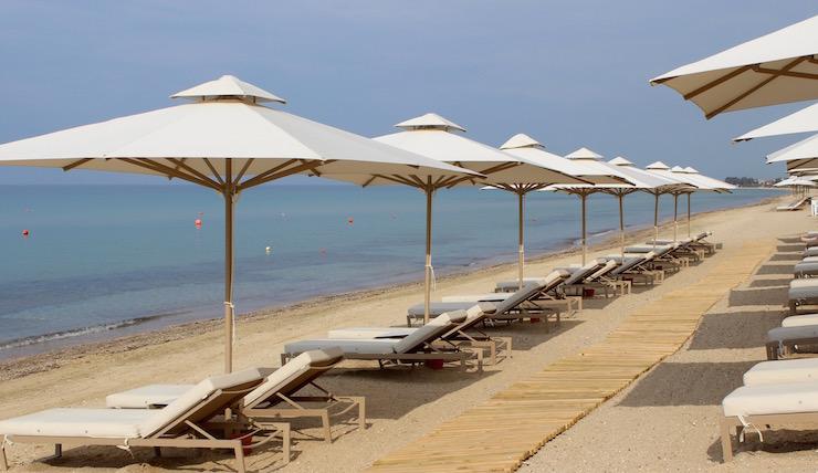 Beach at Ikos Oceania. Copyright Gretta Schifano