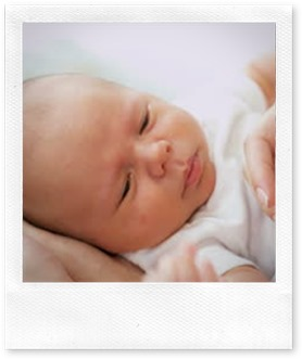 stock-footage-close-up-parent-holding-newborn-baby