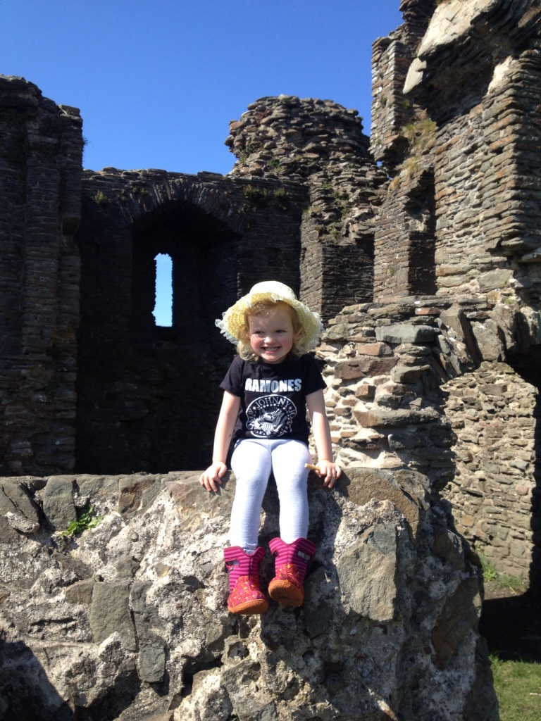 Child sat on castle wales