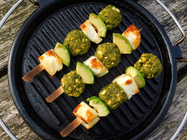 Halloumi and avocado kebabs grilling on a pan