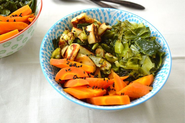 Ginger carrot, halloumi and spring beans in a blue patterned bowl