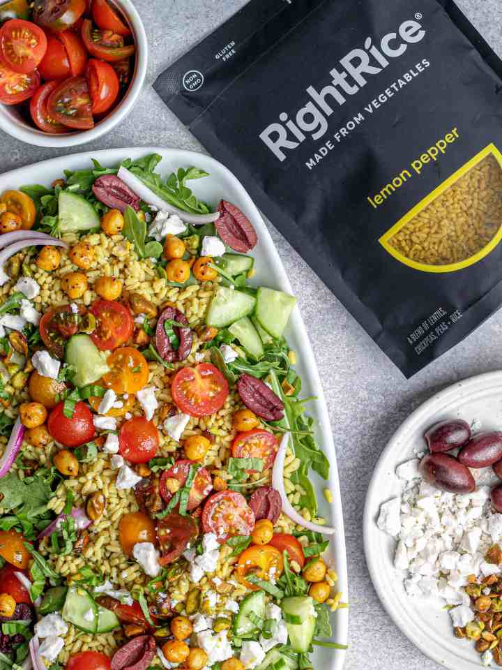 Lemon Pepper Arugula Salad with Spiced Chickpeas, Tomatoes & Pistachios with RightRice, olives, and vegan feta