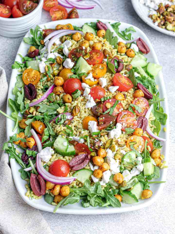 Lemon Pepper Arugula Salad with Spiced Chickpeas, Tomatoes & Pistachios