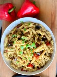 This incredibly delicious and easy grilled peppers and garlic pasta is loaded with mouthwatering flavours. Think fresh and slightly spicy peppers, soft grilled aubergines and a creamy garlic pasta sauce. It's so good and so easy to make. This amazing pasta dish can be served both hot and cold. It's our family favourite pasta salad on a hot summer day. If you're like me and enjoy easy summer dinners and stress free nights then this is the recipe you have been looking for. Munchyesta.com