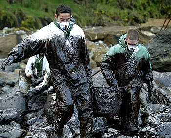 SOLDIERS CARRY A BUCKET FILLED WITH OIL IN NORTHERN SPAIN