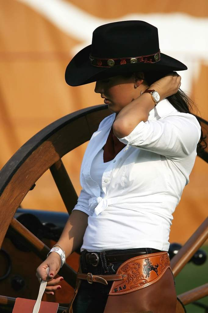 cowgirl, cowboy hat, wagon wheel