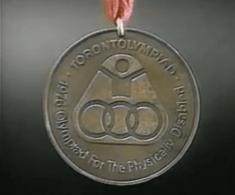 Medalla olimpica, ganada por el campeon guatemalteco Jose Rolando de Leon