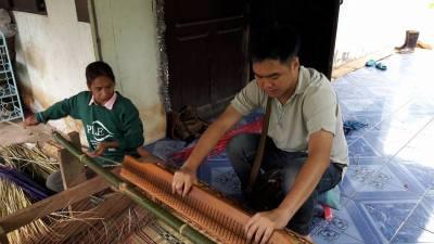 Weaving Mats Together