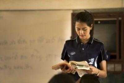 thai teacher holding a lesson book