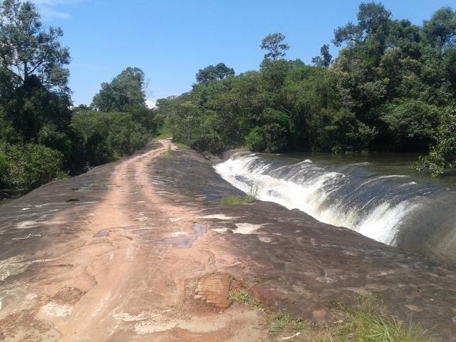 rock bridge over waterfall