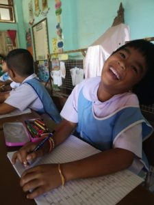 education for kids at a village school girl student laughing