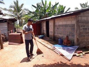 local volunteer helping clean elders homes