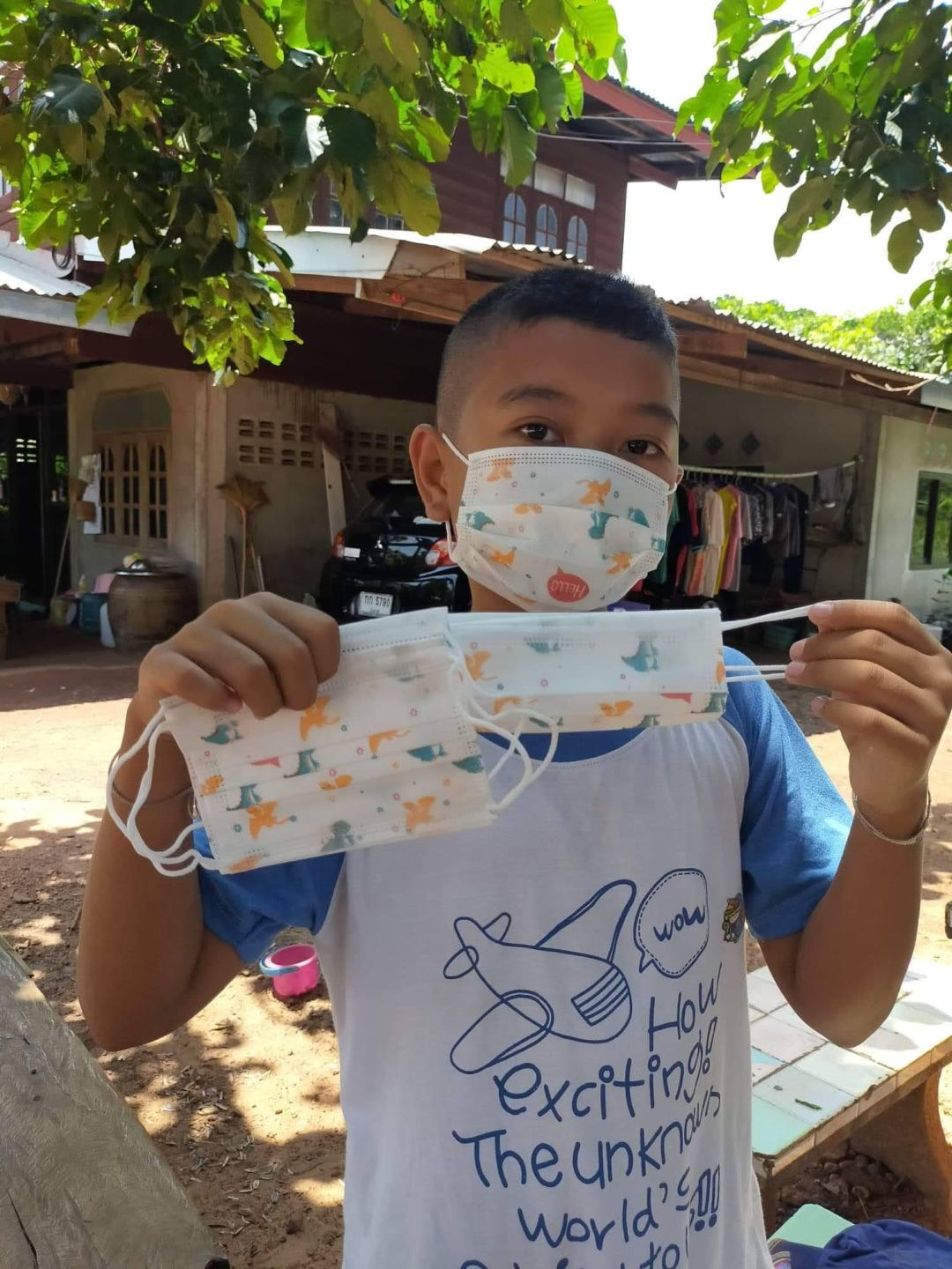 boy with childrens face mask
