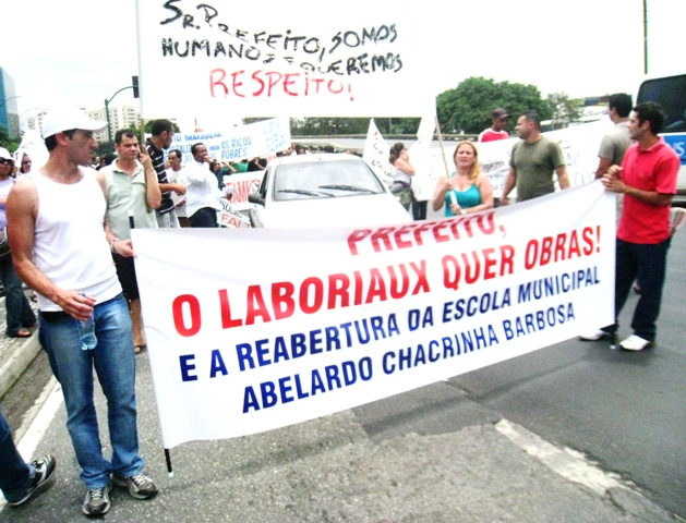 Favela Residents Take To The Street In A Peaceful Demonstration Against Forced Evictions