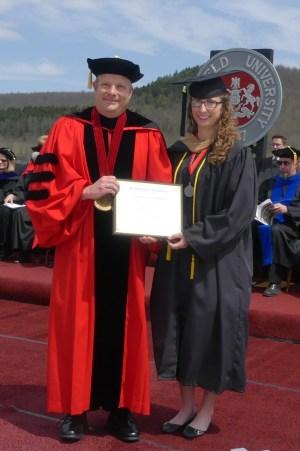 MU President Scott Barton presents the outstanding Senior award to Mackenzie Hafer.