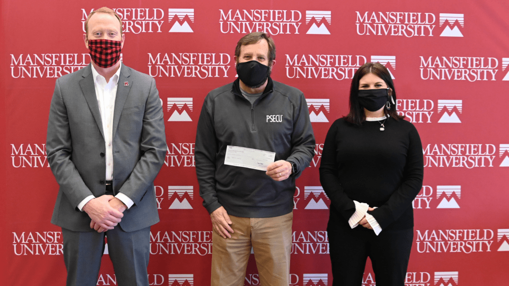 (L-R) President of Mansfield University Dr. Charles Patterson, Director of Alumni Affairs and Advancement Casey Wood, and PSECU Business Advisor Dave Sikorski.