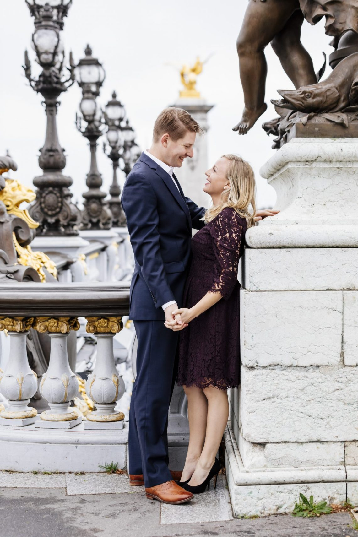 Couple photo in Paris in the fall. Navy suit and maroon dress