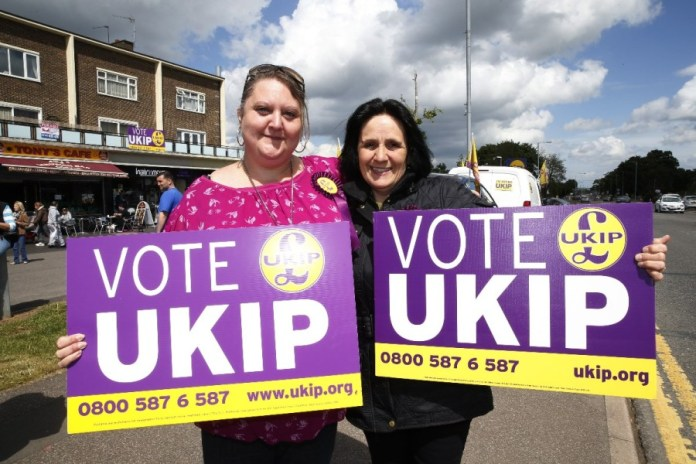 Supporters of Britain's United Kingdom Independence Party (UKIP) pose for pictures in South Ockendon, England, Friday, May 23, 2014. UKIP, Britain's anti-European party has made big gains in local elections, taking votes from both the governing Conservatives and main opposition Labour Party. It's a strong performance for the U.K. Independence Party, which advocates pulling Britain out of the EU and stopping the unfettered right to entry of European citizens. With about a third of results declared Friday from voting for 161 local authorities, UKIP had almost 100 seats, well over its predicted total of 80. Britons also voted Thursday in European Parliament elections. Those results will be announced Sunday along with tallies from 27 other EU countries. (AP Photo/Lefteris Pitarakis)