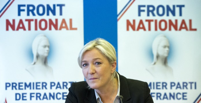 French far-right National Front party leader Marine Le Pen listens during a meeting at their headquarters in Nanterre, west of Paris, Tuesday, May 27, 2014. The anti-EU, anti-immigration National Front party shook France's political landscape by coming out on top in France's voting for European Parliament elections, beating the mainstream conservatives and the governing Socialists. (AP Photo/Jacques Brinon)