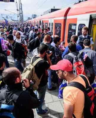 Refugees at Munich's main train station last year. German civil society is trying hard to make sure the migration phenomenon ends on a positive note. Photograph: Nicolas Armer/EPA