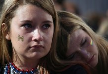 Dejected Clinton supporters at an election night rally in New York. Clinton supporters across the U.S. were stunned at their candidate's surprise loss Tuesday night. (Adrees Latif/Reuters)