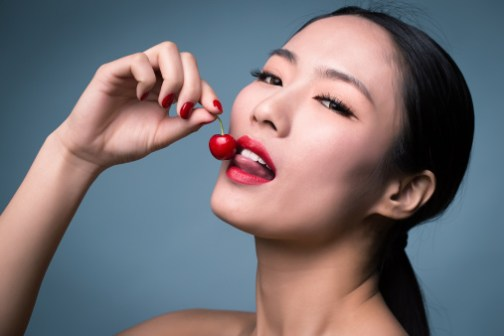 Asian women face makeup and cherry