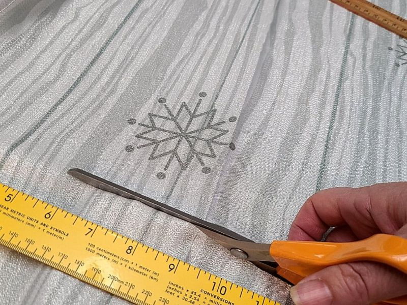 cutting holiday fabric