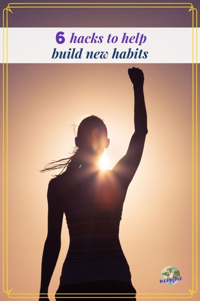 "woman raising her arm in the sunlight with text overlay ""6 hacks to help you build new habits"""