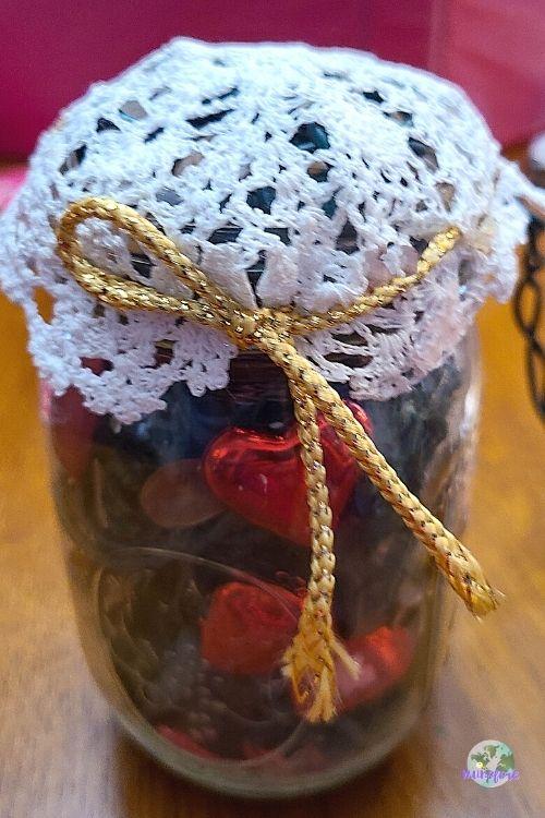 doily tied around a mason jar filled with potpourri