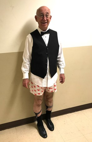 Photo of Jim Holman wearing vest and bow tie and boxer shorts in New Wrinkles.