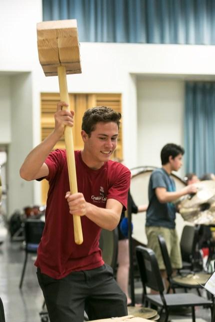 The hammer man: Robbie Darling wields a big stick at a Fresno State rehearsal. Photo / Todd Sharp, CSU Summer Arts