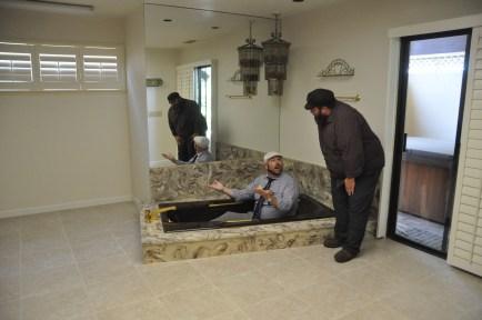 Indoor plumbing: Adam Kitt shows Tevye how it's done.