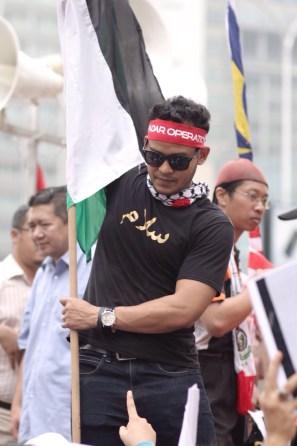 Standing proud waving palestine flag