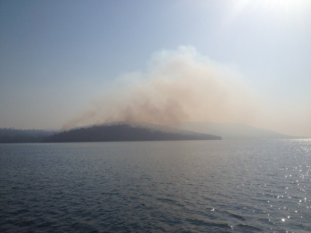 smoke plumes from the dense bush between Flinders Bay and Eaglehawk Neck.