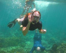 Jasmine duck diving the reef