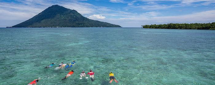 Family snorkeling in Bunaken