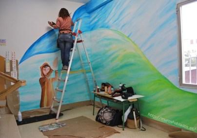 Nívola pintando un retrato en lo alto