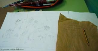 El boceto junto a las anotaciones que Nívola hace de los comentarios que escucha de los niños