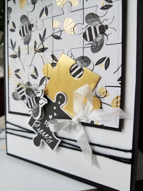 view of puzzle, bee, and ribbon layers
