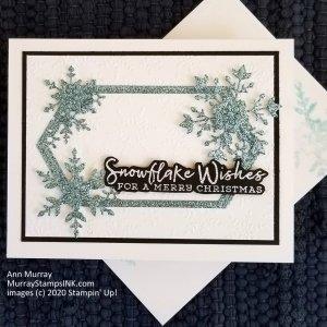blue glitter snowflake frame on embossed background
