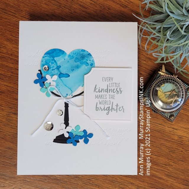 smooshed Shimmery White cardstock in blue ink to create background paper for hearts