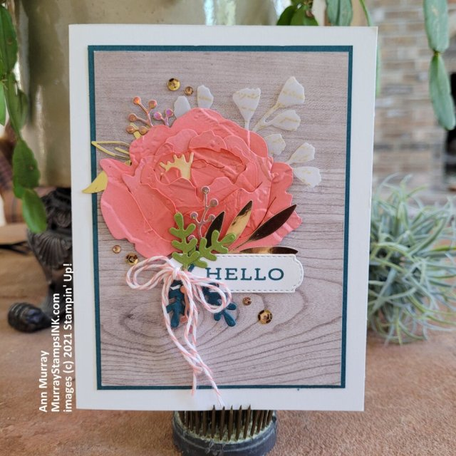 Flirty Flamingo peony embossed with painted texture and layered with miscellaneous foliage parts