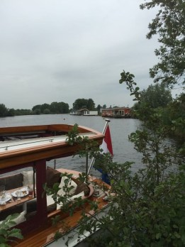 The houseboat in the background