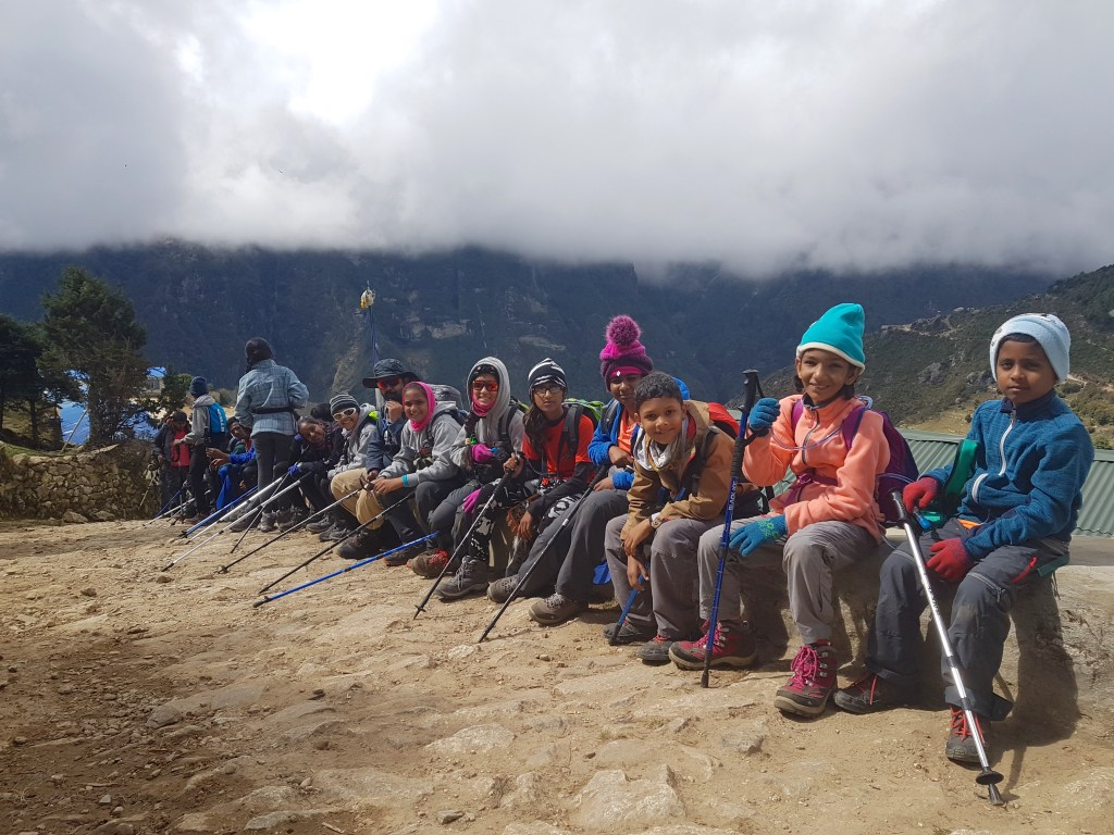 children trekking Nepal