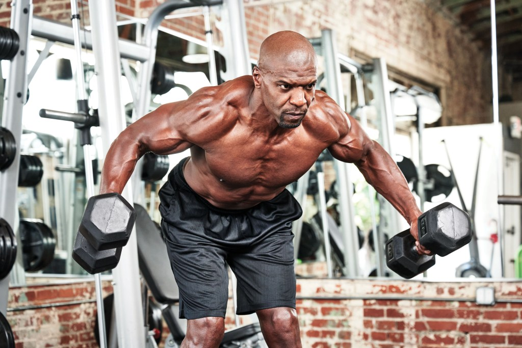 Terry Crews performing Dumbbell flys
