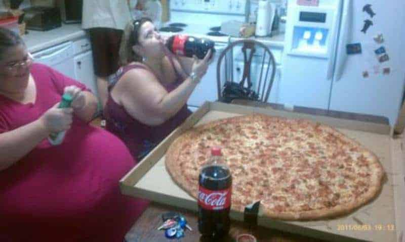 fat person eating pizza