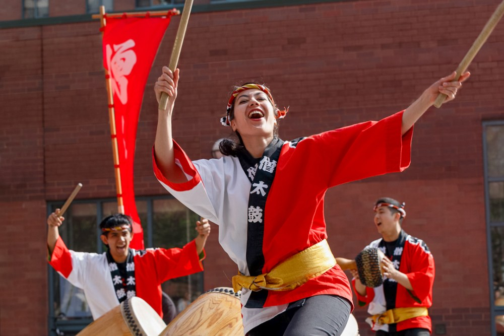 Japanese taiko performers in a strong performance