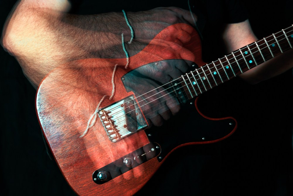special effects shot of guitar being strummed