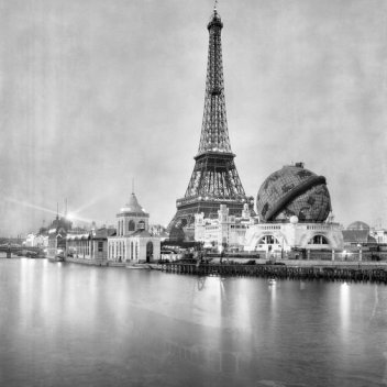Paris World Fair. The river Seine, the Eiffel Tower and the giant terrestrial globe at night, Paris (France), 1900, photograph by Neurdein, © Neurdein/Roger Viollet