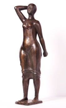 "Elizabeth Catlett, American (born 1915), ""Standing Woman,"" 1987, bronze, 33 x 9½ x 7 inches, Gift of Drs. William and Camille Cosby, 1987.1"